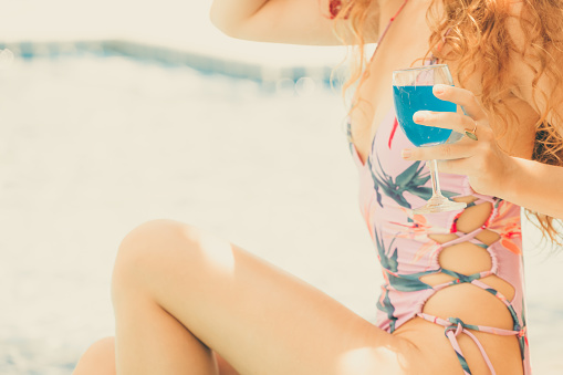 1062333060 istock photo Happy young woman in swimsuit at swimming pool. 1062333006
