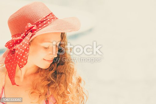 1062333060istockphoto Happy young woman in swimsuit at swimming pool. 1062333052