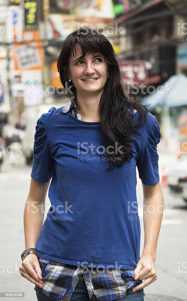 Happy Young Woman in the City stock photo