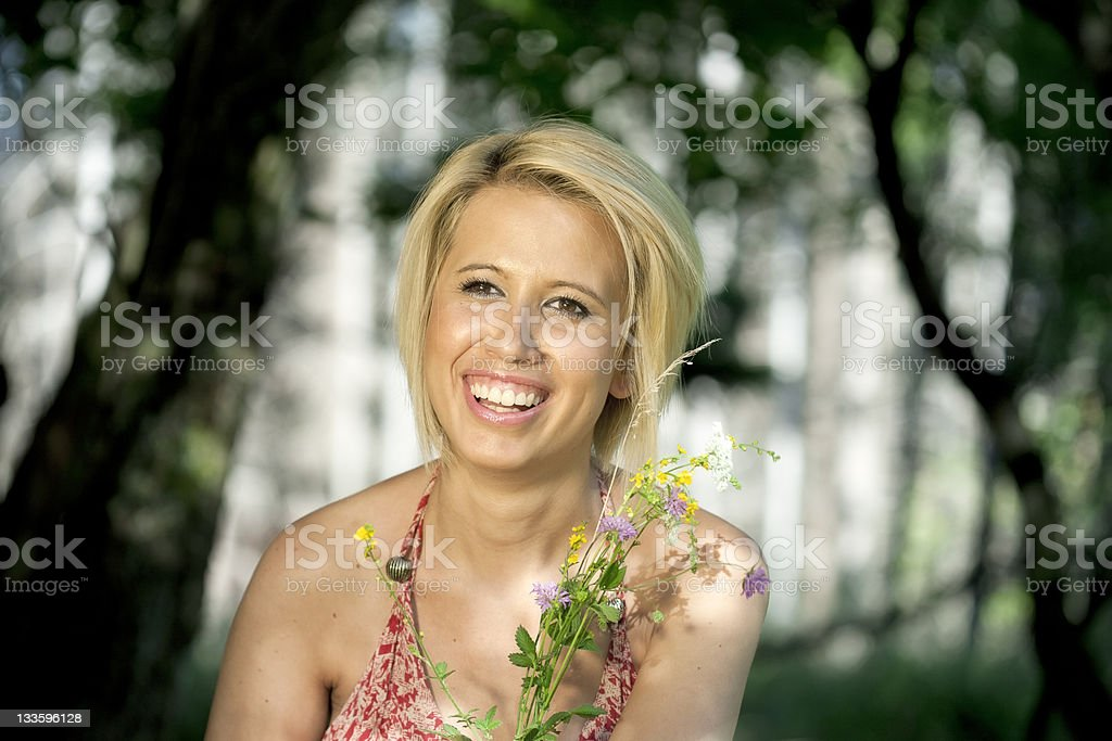Happy young woman in the forest stock photo