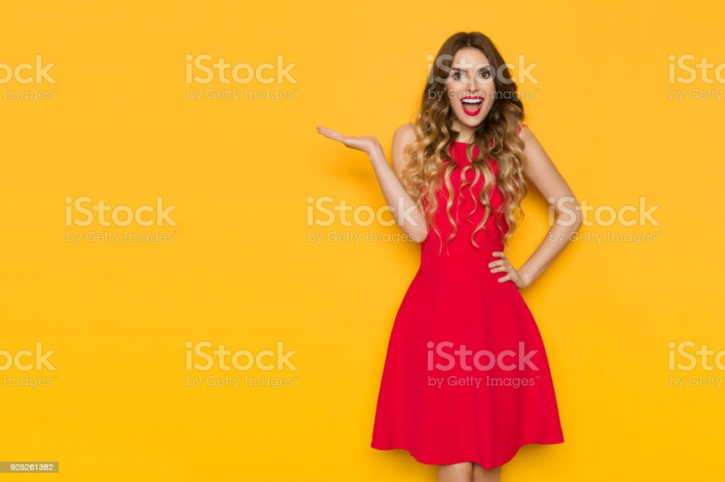 Happy Young Woman Is Holding Hand Raised, Presenting And Shouting royalty-free stock photo