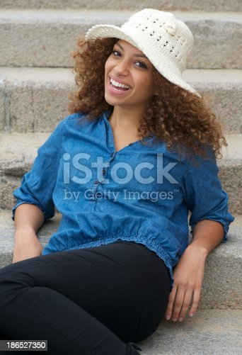 186534921 istock photo Happy young woman laughing outdoors 186527350