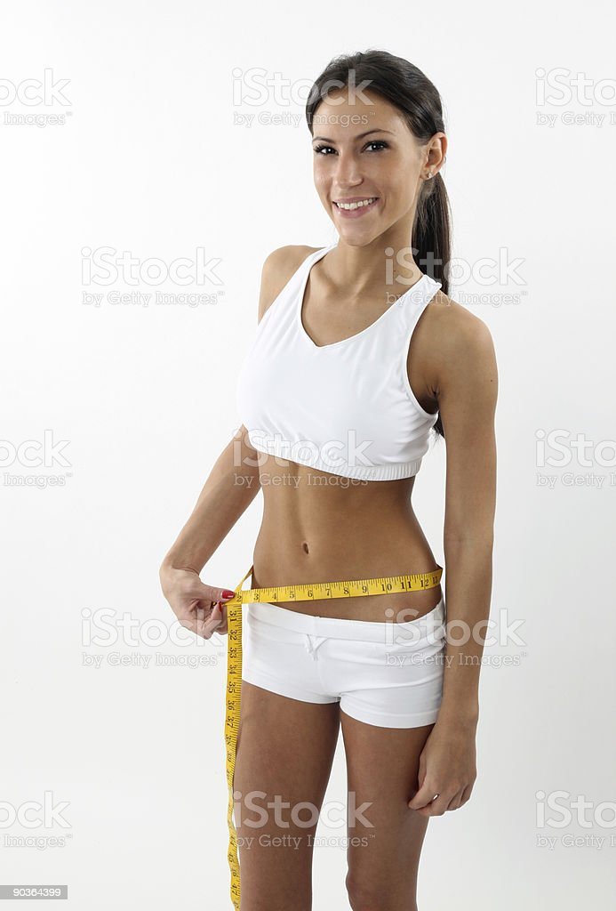 Happy young woman measuring her waist royalty-free stock photo