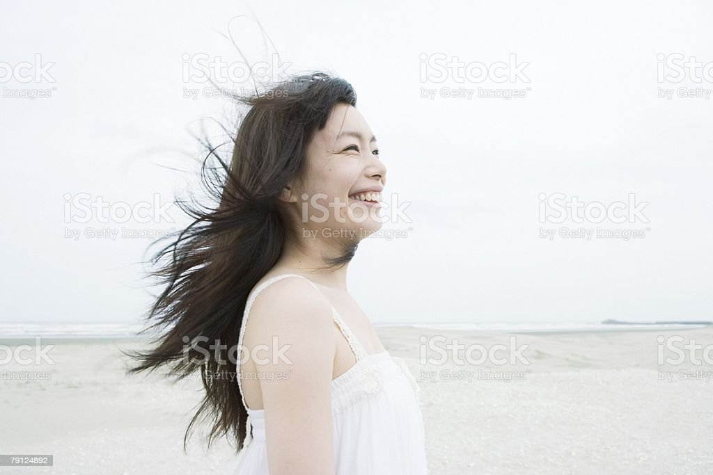 Happy young woman on beach 免版稅 stock photo