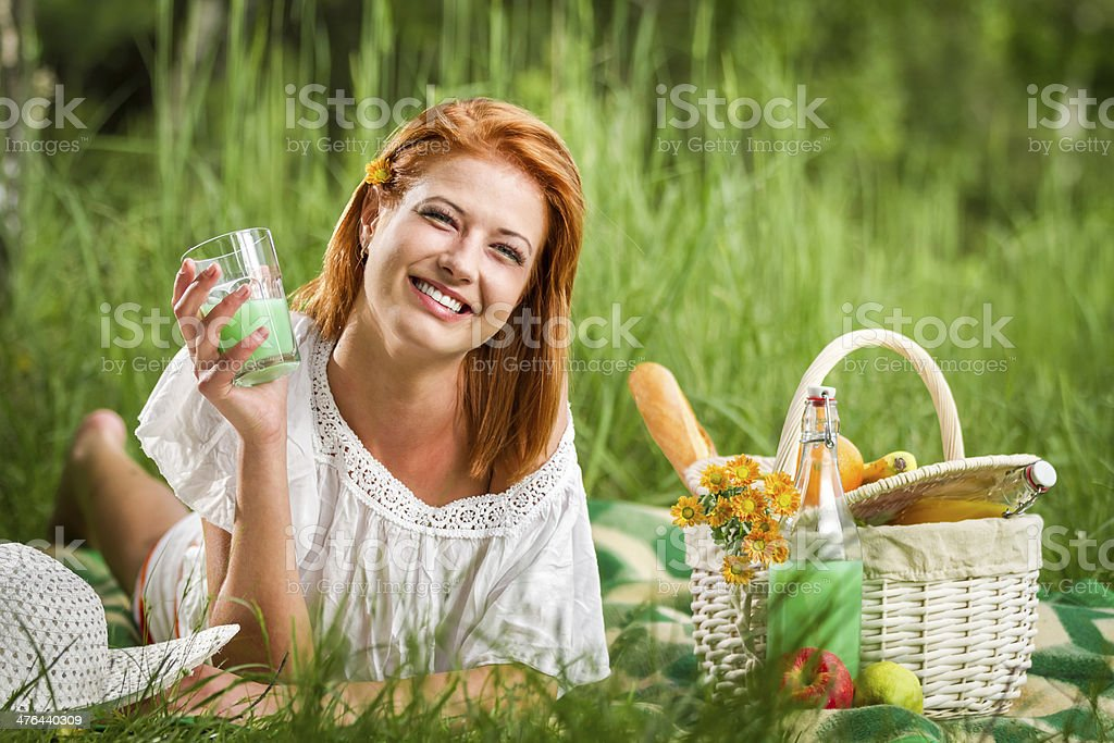 Happy young woman on picnic in summer royalty-free stock photo