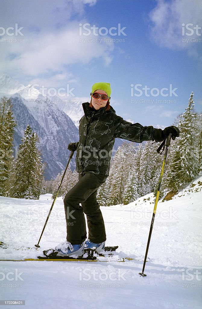 Happy young woman on ski vacation in Italian Alps royalty-free stock photo