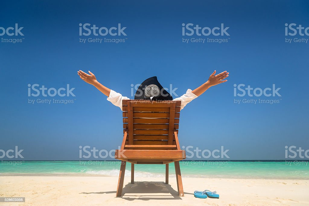 Happy young woman on the beach stock photo