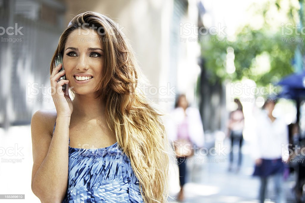 Happy Young Woman on the Phone royalty-free stock photo
