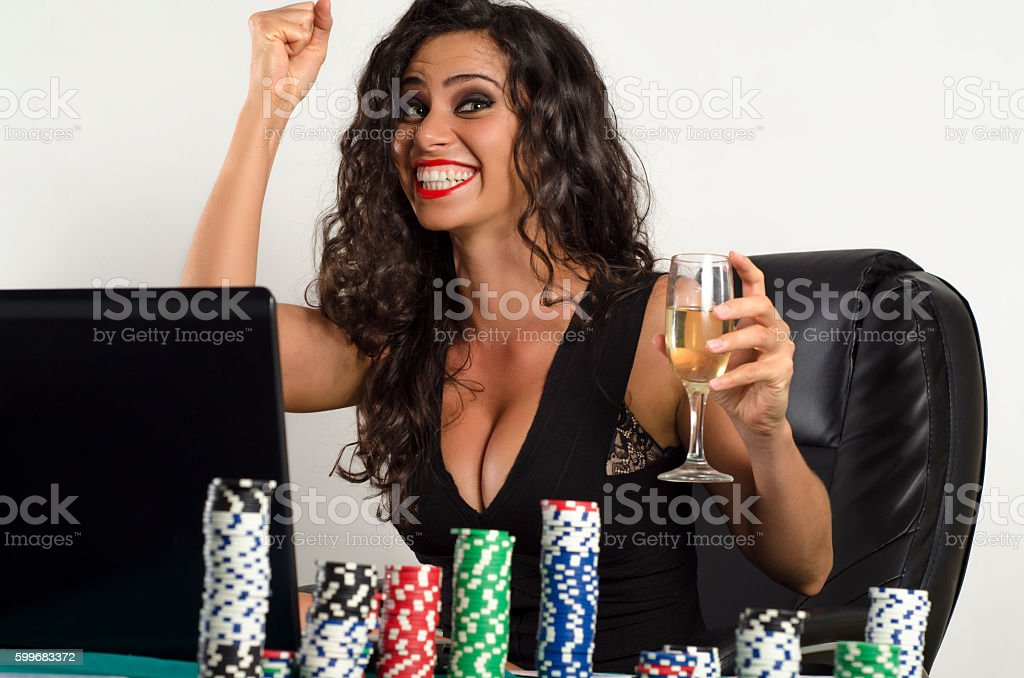 Happy young woman online poker success stock photo