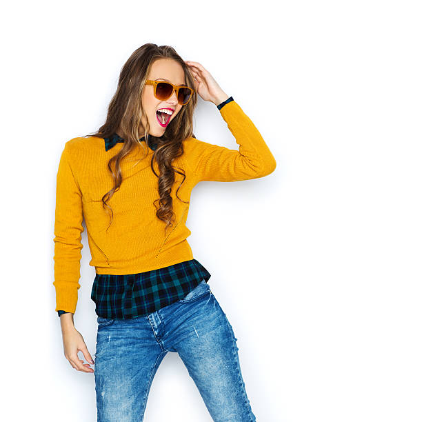 happy young woman or teen girl in casual clothes - hipster fashion stock photos and pictures
