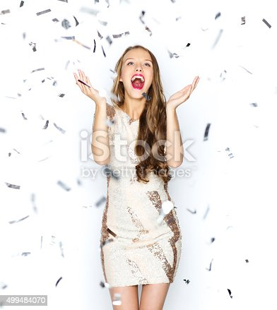 istock happy young woman or teen girl in fancy dress 499484070