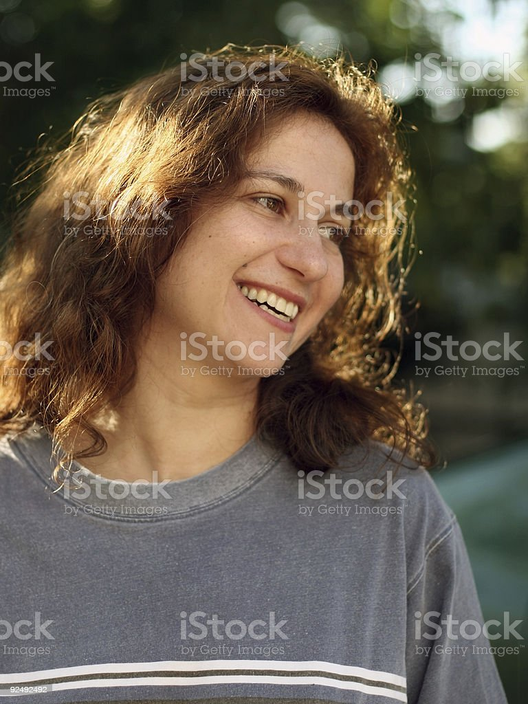 Happy young woman outdoors royalty-free stock photo