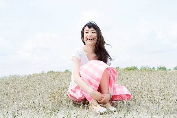 Happy young woman  only japanese stock pictures, royalty-free photos & images