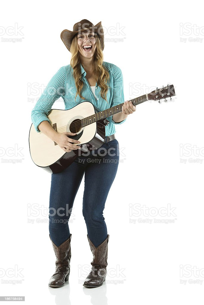 Happy young woman playing guitar royalty-free stock photo