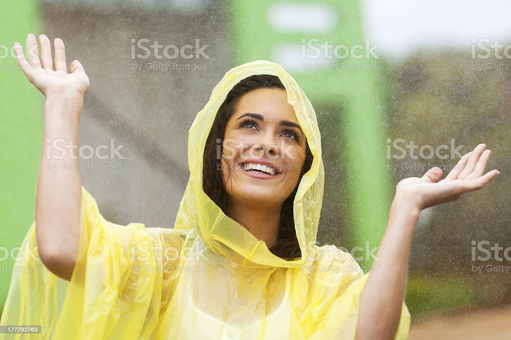 happy young woman playing in rain stock photo