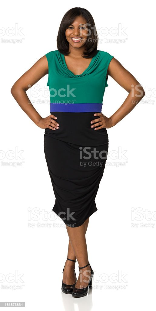 Happy Young Woman Posing, Hands On Hips, Legs Crossed royalty-free stock photo