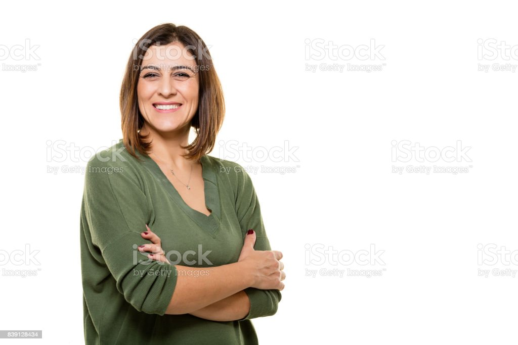 Happy young woman posing on white background. stock photo