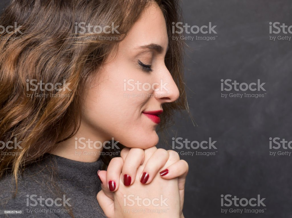 Happy young woman praying stock photo