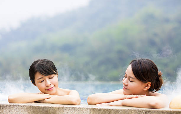 happy young woman relaxing in  hot springs - hot spring stock photos and pictures