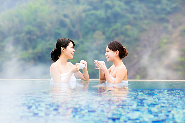 happy young woman relaxing in  hot springs - japanese bath woman bildbanksfoton och bilder