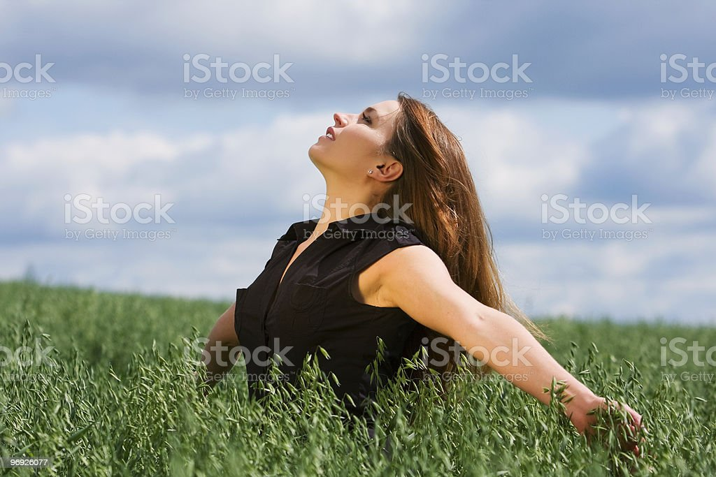 Happy young woman relaxing on nature royalty-free stock photo