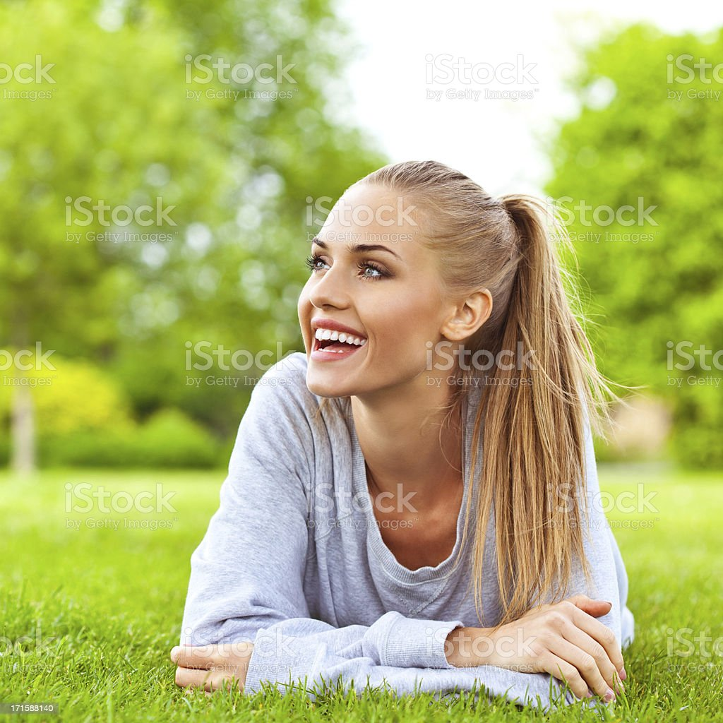 Happy young woman resting a park royalty-free stock photo