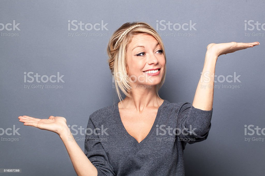 happy young woman scaling or weighting on flat empty hands stock photo