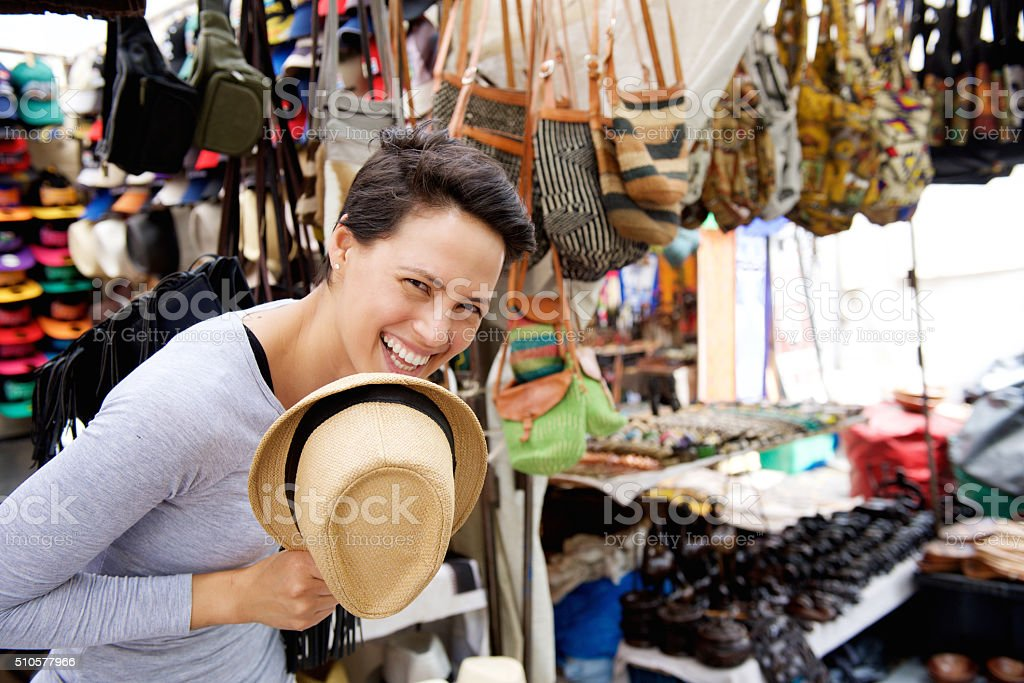 Happy young woman shopping at market stock photo
