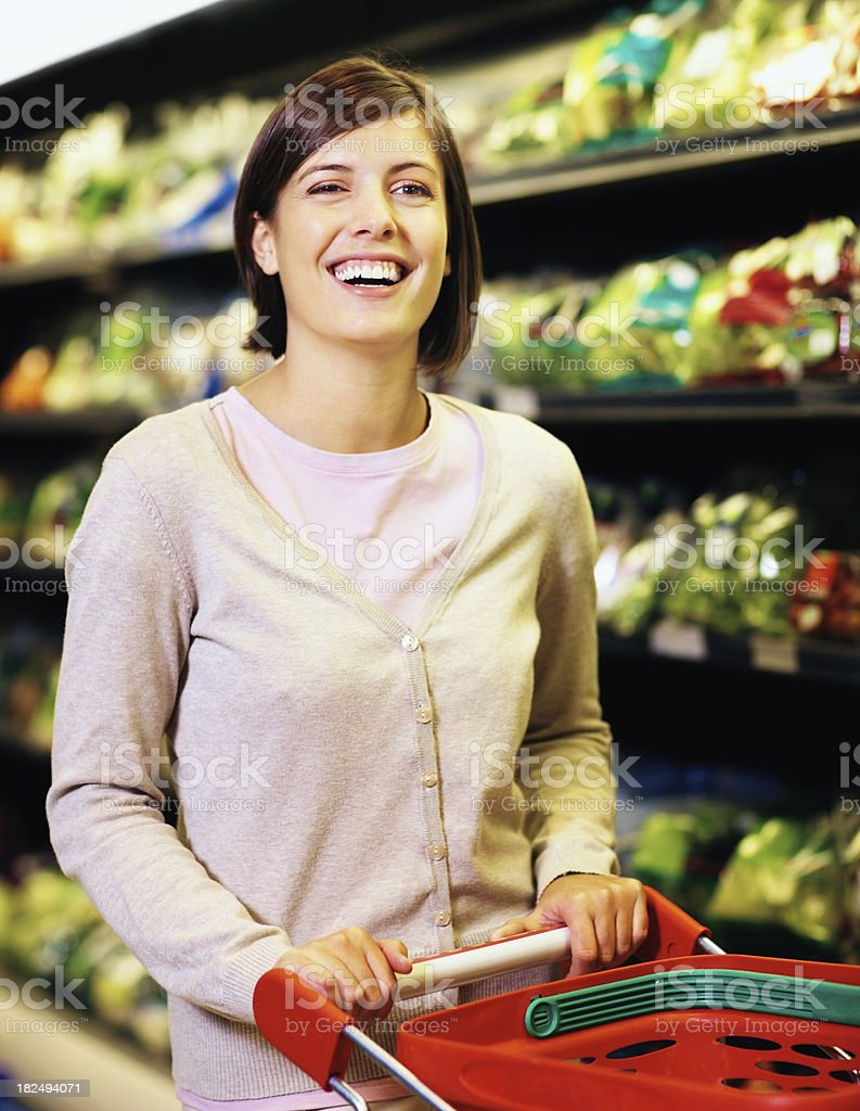 Happy young woman shopping at the supermarket royalty-free stock photo