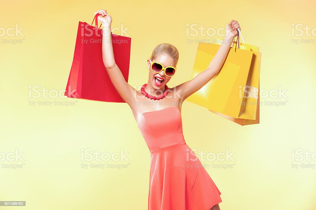 Happy young woman shopping in black friday holiday. Girl with photo libre de droits