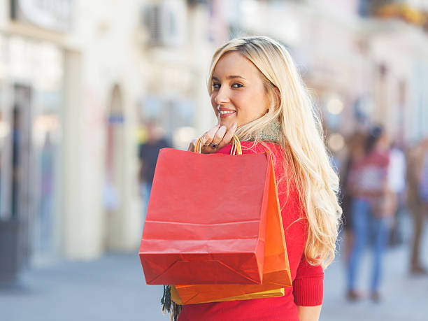Happy young woman shopping stock photo