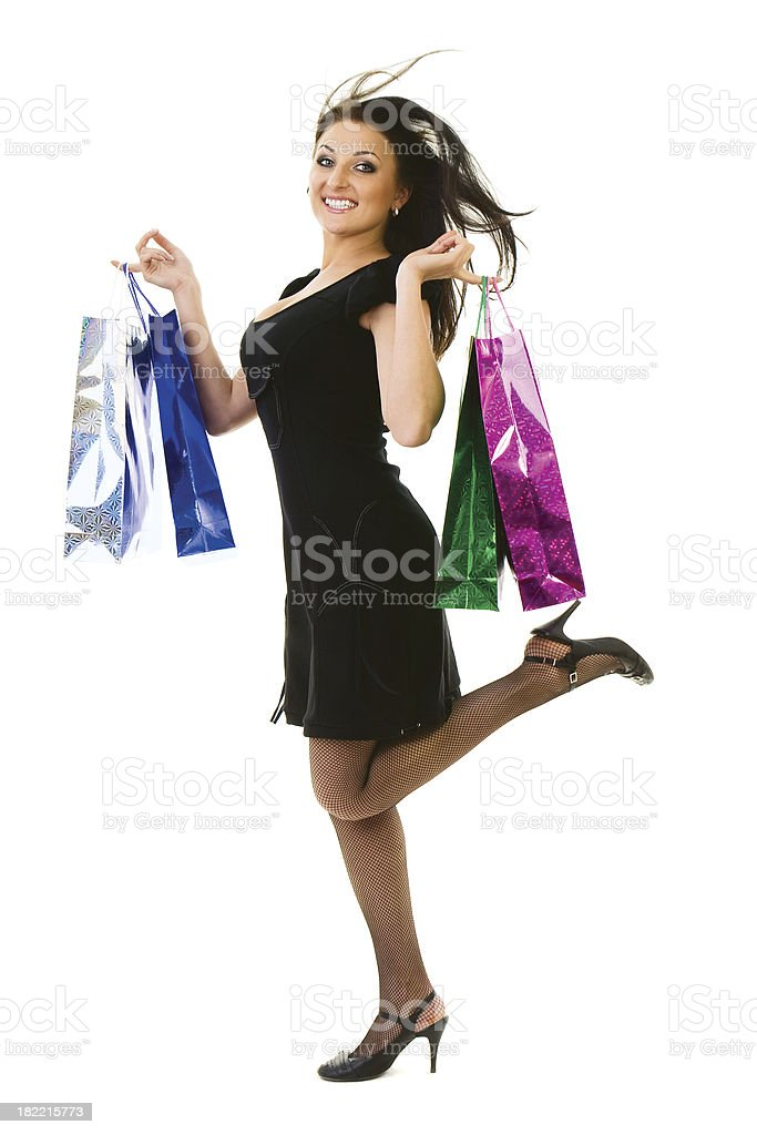 Happy young woman shopping royalty-free stock photo