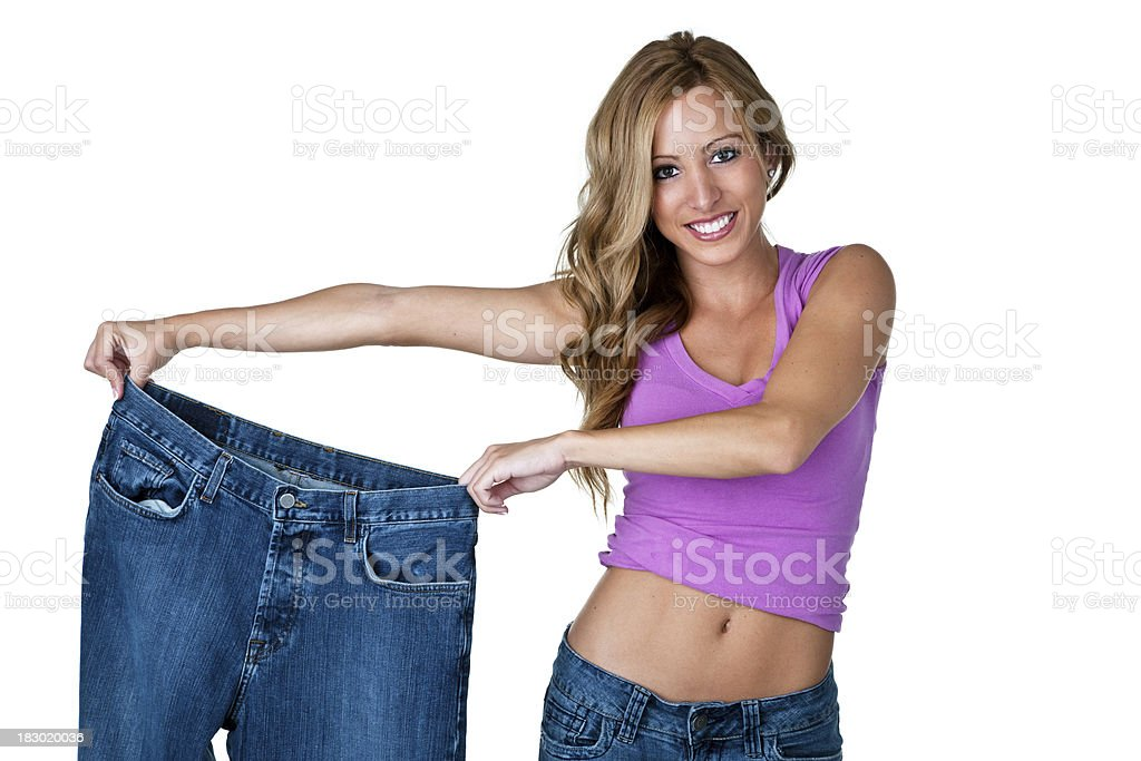 Happy young woman showing her weight loss results royalty-free stock photo