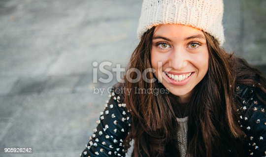 istock Happy young woman smiling on the street 905926242