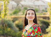 istock Happy young woman smiling portrait, outdoors 1173379525
