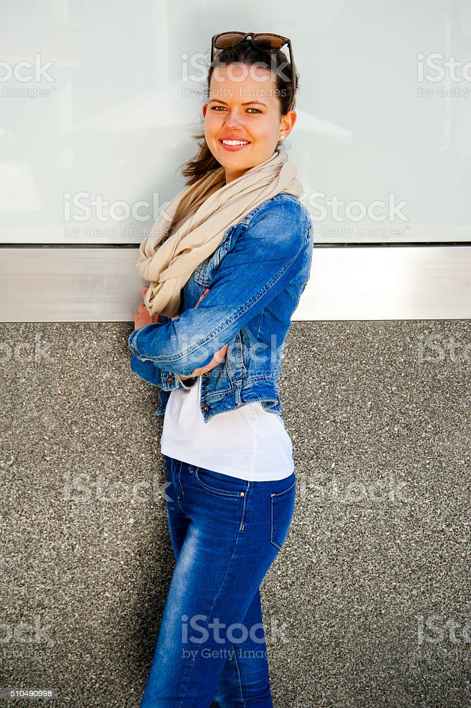 Happy young woman smiling with copy space with sunglasses. stock photo