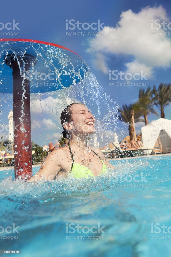 Happy Young Woman Standing In Swimming Pool royalty-free stock photo