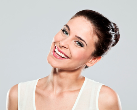 Happy Young Woman Studio Portrait Stock Photo - Download Image Now