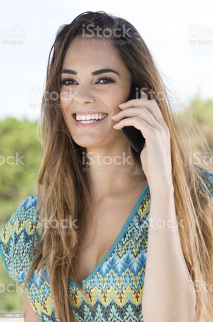 Happy Young Woman Talking On Cellphone royalty-free stock photo