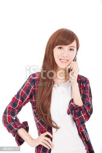 istock happy young woman talking on the phone 462061117