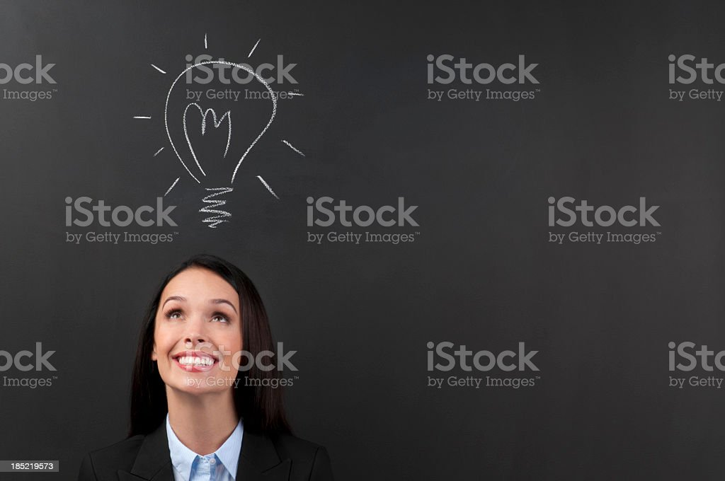 Happy young Woman Thinking a big idea royalty-free stock photo