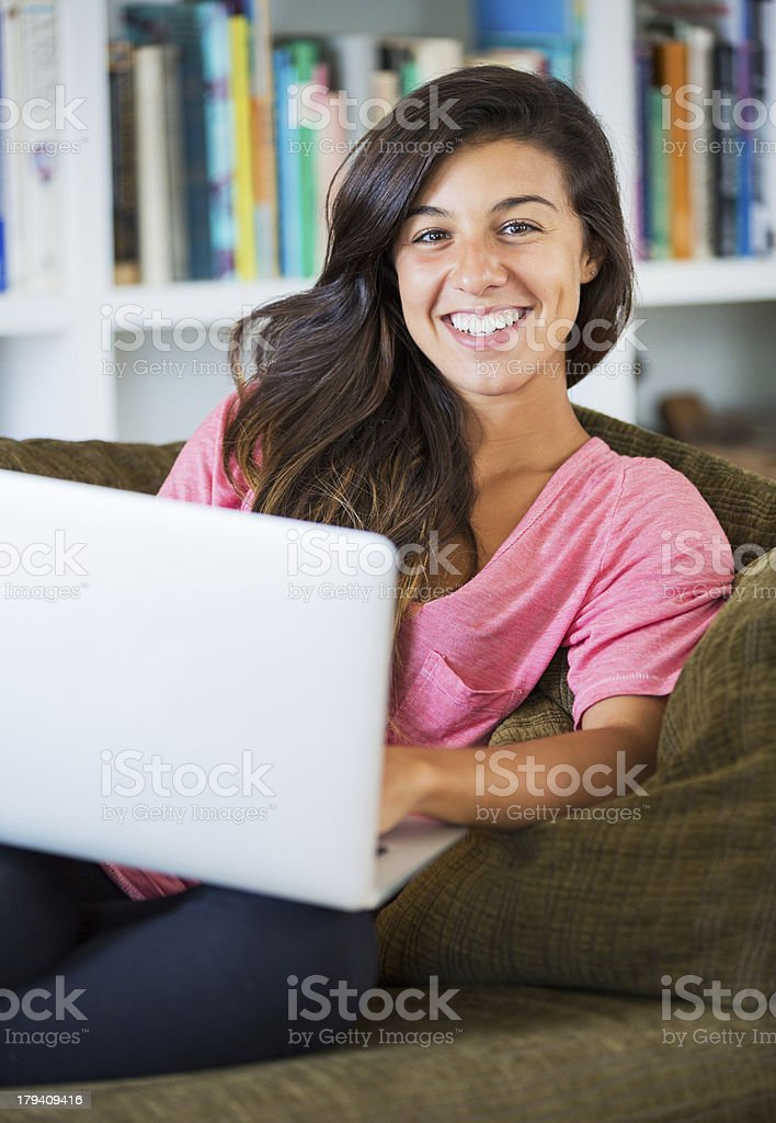 happy young woman using a laptop computer royalty-free stock photo