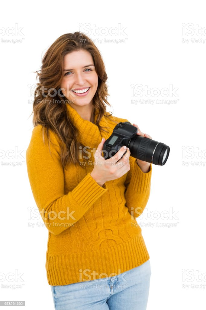 Happy young woman using camera royalty-free stock photo