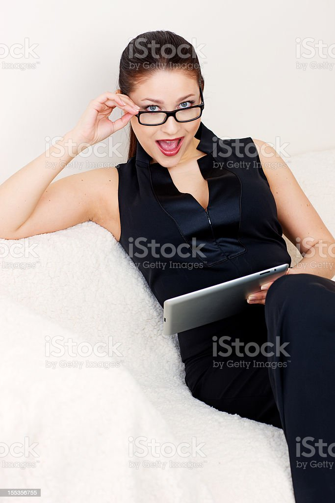 Happy Young Woman using digital tablet royalty-free stock photo