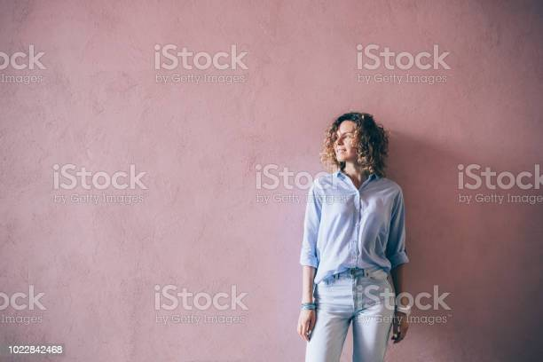 Happy young woman wearing blue casual outfit picture id1022842468?b=1&k=6&m=1022842468&s=612x612&h=9yqzujamtplv1ohf2 r3qjzivv8q x9ajj6lo0mo3y4=