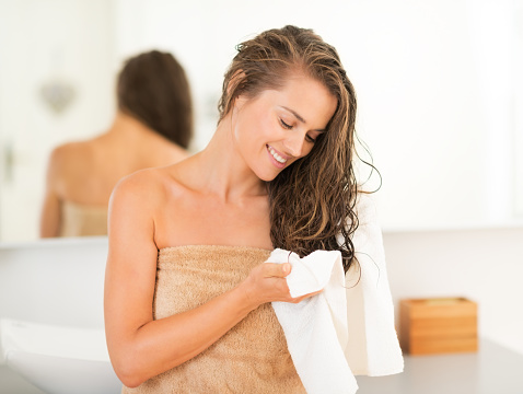 Happy Young Woman Wiping Hair With Towel In Bathroom Stock Photo - Download Image Now