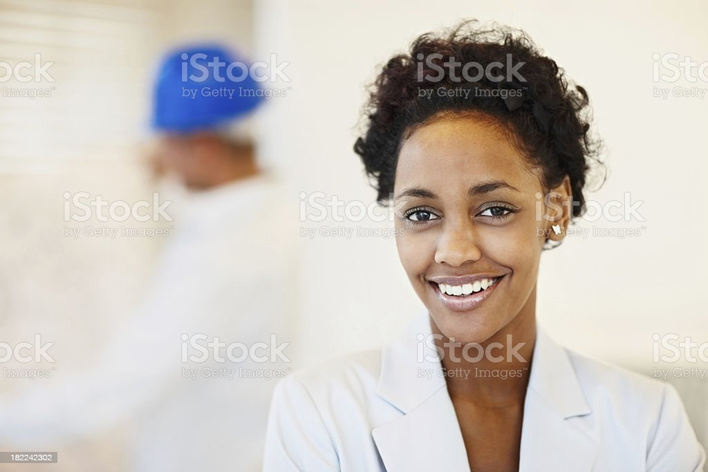 Happy young woman with architect at the back royalty-free stock photo