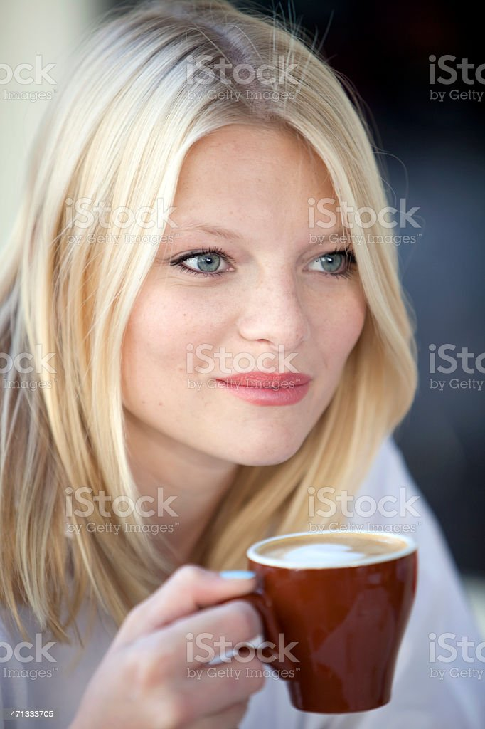 HAppy young woman with cappuccino royalty-free stock photo