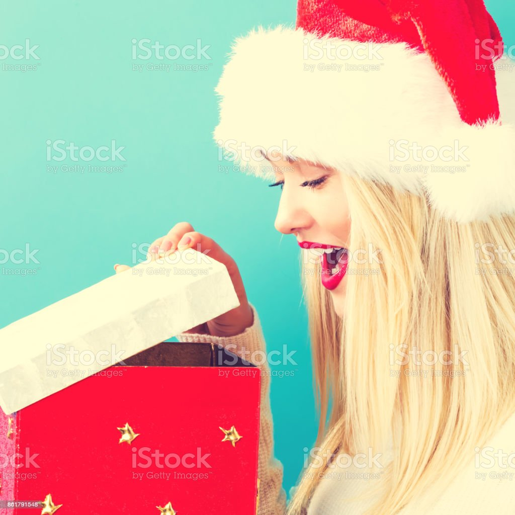 Happy young woman with Christmas gift stock photo
