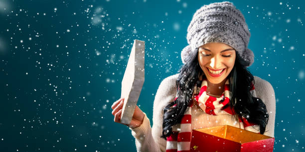 happy young woman with christmas present box - prenda imagens e fotografias de stock